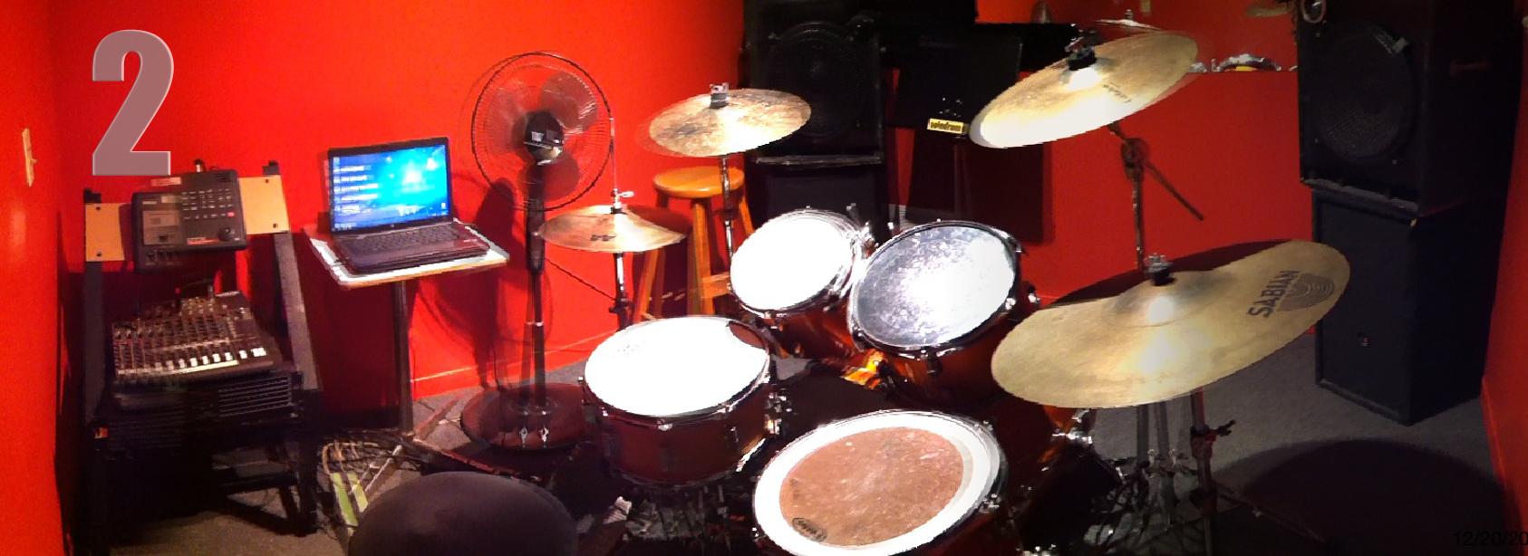 (10' x 10') drum set and a laptop