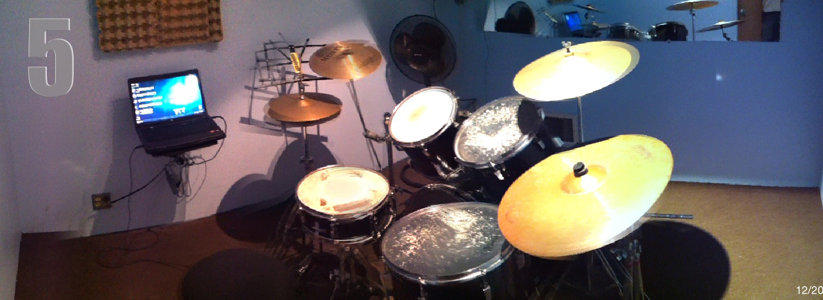 (10' x 10') drum set and a laptop. Cymbals included